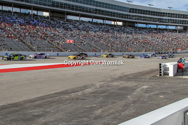 Nascar race cars in action during the Monster Energy NASCAR Cup Series, AAA Texas 500, race at the Texas Motor Speedway in Fort Worth,Texas.