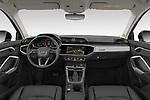 Stock photo of straight dashboard view of 2019 Audi Q3 Advanced 5 Door SUV Dashboard
