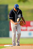 Starting pitcher Peter Tago #26 of the Asheville Tourists uses the rosin bag during the game against the Kannapolis Intimidators at Fieldcrest Cannon Stadium on July 28, 2011 in Kannapolis, North Carolina.  The Intimidators defeated the Tourists 2-1 in 10 innings.   (Brian Westerholt / Four Seam Images)