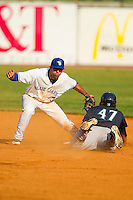 Jabari Henry #47 of the Pulaski Mariners steals second base ahead of the tag from Bluefield Blue Jays shortstop Jason Leblebijian #13 at Bowen Field on July 1, 2012 in Bluefield, West Virginia.  The Mariners defeated the Blue Jays 4-3.  (Brian Westerholt/Four Seam Images)
