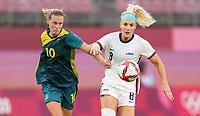 KASHIMA, JAPAN - JULY 27: Emily van Egmond #10 of Australia battles with Julie Ertz #8 of the United States before a game between Australia and USWNT at Ibaraki Kashima Stadium on July 27, 2021 in Kashima, Japan.