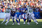 Buffalo Bills quarterback Josh Allen (17) looks to pass in the pocket during an NFL football game against the New York Jets, Sunday, December 9, 2018, in Orchard Park, N.Y.  (Mike Janes Photography)