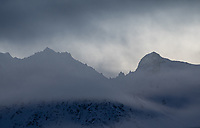 Clouds move through the pass between the Chugach and Talkeetna Mountains in Southcentral Alaska.