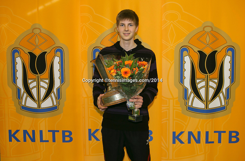 Rotterdam, The Netherlands, 15.03.2014. NOJK 14 and 18 years ,National Indoor Juniors Championships of 2014, Trophy giving on court, winner boys 18 years Gijs Brouwer<br /> Photo:Tennisimages/Henk Koster