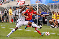Osman Chavez (2) of Honduras challenges Alvaro Sabori?o (9) of Costa Rica for the ball during a quarterfinal match of the 2011 CONCACAF Gold Cup at the New Meadowlands Stadium in East Rutherford, NJ, on June 18, 2011.