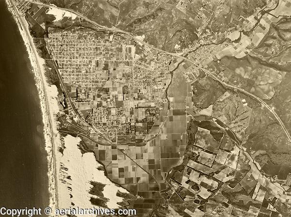 historical aerial photograph of Arroyo Grande,  Grover Beach, Oceano and the Oceano Dunes, San Luis Obispo County, California, 1960
