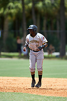 GCL Pirates first baseman Cristopher Perez (10) leads off first base during a game against the GCL Tigers West on July 17, 2017 at TigerTown in Lakeland, Florida.  GCL Tigers West defeated the GCL Pirates 7-4.  (Mike Janes/Four Seam Images)