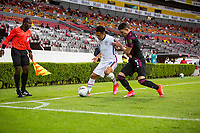 , MEXICO - : Sebastian Saucedo #10 of the United States dribbles the ball into the corner with Manuel Mayorga #3 of Mexico during a game between  and undefined at  on ,  in , Mexico.