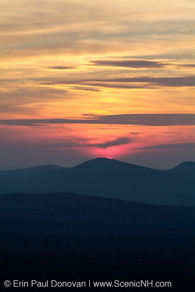 Sunset from the summit of North Sugarloaf Mountain during the summer months in the White Mountains, New Hampshire.