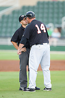 Kannapolis Intimidators manager Pete Rose Jr. (14) gets his monies worth after having been ejected from the game by umpire Rich Grassa during the game against the Lakewood BlueClaws at CMC-NorthEast Stadium on July 20, 2014 in Kannapolis, North Carolina.  The Intimidators defeated the BlueClaws 7-6. (Brian Westerholt/Four Seam Images)