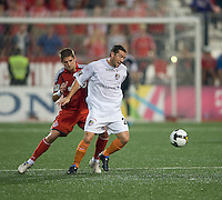 29 July 2009: Puerto Rico Islanders midfielder Daniel Gargan #24 and Toronto FC midfielder Carl Robinson #33 in action during a CONCACAF game at BMO Field in Toronto between the Puerto Rico Islanders and Toronto FC.The Puerto Rico Islanders won 1-0..