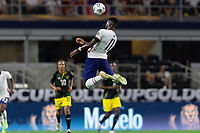DALLAS, TX - JULY 25: Daryl Dike #11 of the United States wins the header during a game between Jamaica and USMNT at AT&T Stadium on July 25, 2021 in Dallas, Texas.