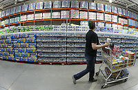 Tracey Mason, of Westerville, enjoys a cup of coffee as she shops at a Costco Wholesale Warehouse Friday, March 9, 2007 in Columbus, Ohio.