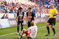 Antoine Hoppenot (29) of the Philadelphia Union and Markus Holgersson (5) of the New York Red Bulls exchange words. The New York Red Bulls defeated the Philadelphia Union 2-1 during a Major League Soccer (MLS) match at Red Bull Arena in Harrison, NJ, on March 30, 2013.