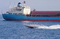 - Financial police, fast motor patrol vessel controls a ship in the gulf of Naples ....- Guardia di Finanza, motovedetta veloce controlla una nave  nel golfo di Napoli