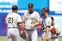 Mitch Stetter #26 of the Salt Lake Bees is removed from the game by Bees manager Keith Johnson #21 after pitching against the Las Vegas 51s at Cashman Field on May 27, 2013 in Las Vegas, Nevada. Las Vegas defeated Salt Lake, 9-7. (Larry Goren/Four Seam Images)