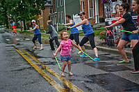 Going girl dancing on west street during Fourth Friday celebration in Westerville, Ohio.