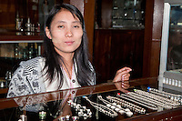 Myanmar, Burma.  Young Burmese Woman Offering Necklaces for Sale, Inle Lake, Shan State.  She has traces of thanaka paste on her face, a Burmese cosmetic sunscreen.