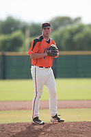 San Francisco Giants relief pitcher John Gavin (57) prepares to deliver a pitch during an Instructional League game against the Kansas City Royals at the Giants Training Complex on October 17, 2017 in Scottsdale, Arizona. (Zachary Lucy/Four Seam Images)