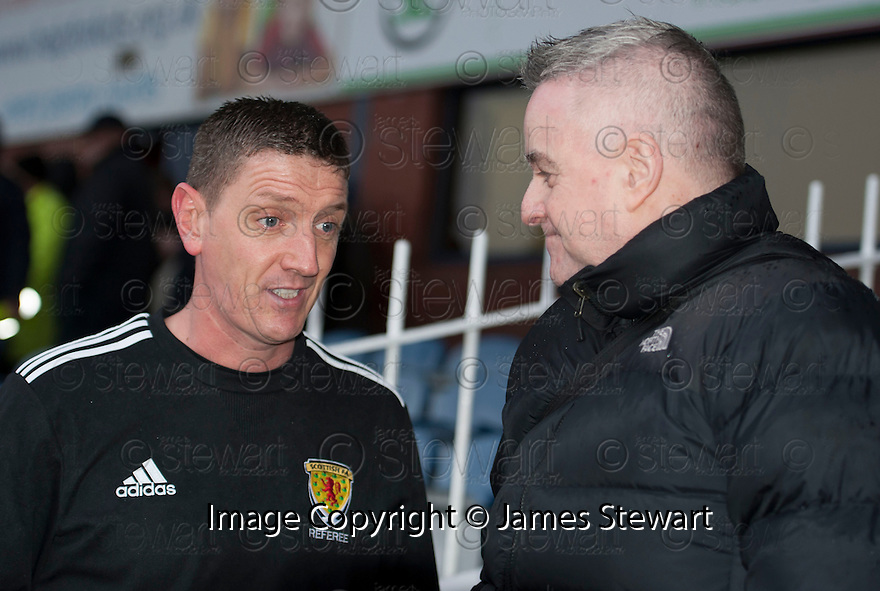 Referee Craig Thomson explains his decision to call off the game at Dens Park to Sun Sports, Bill Leckie.