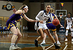 SIOUX FALLS, SD - MARCH 7: Paige Bradford #23 of the UMKC Kangaroos drives against Evan Zars #54 of the Western Illinois Leathernecks during the Summit League Basketball Tournament at the Sanford Pentagon in Sioux Falls, SD. (Photo by Dave Eggen/Inertia)