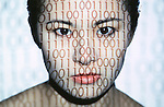 Asian woman with 1's and zeros projected on her face