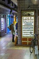 Essaouira, Morocco.  Woman Looking in Window in the Jewelry Market.