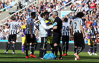 Pictured: Referee Chris Foy is checked over by the Newcastle United physio after getting knocked over by a deflection from a Jonjo Shelvey shot of Swansea. Saturday 19 April 2014<br /> Re: Barclay's Premier League, Newcastle United v Swansea City FC at St James Park, Newcastle, UK.