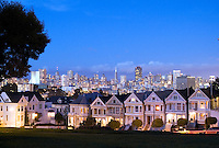 Famous Victorian Houses with beautiful scenic of skyline in tourist haven San Francisco California showing also Tranamerica Pyramid Buildin