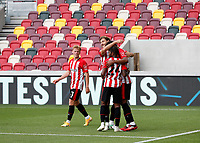 6th September 2020; Brentford Community Stadium, London, England; English Football League Cup, Carabao Cup, Football, Brentford FC versus Wycombe Wanderers; Ethan Pinnock of Brentford celebrates with his team mates after scoring his sides 1st goal in the 34th minute to make it 1-0