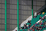 Hibernian 3 Alloa Athletic 0, 12/09/2015. Easter Road stadium, Scottish Championship. Home fans enjoying some sunshine in the East Stand at Easter Road stadium during the first-half of the Scottish Championship match between Hibernian and visitors Alloa Athletic. The home team won the game by 3-0, watched by a crowd of 7,774. It was the Edinburgh club's second season in the second tier of Scottish football following their relegation from the Premiership in 2013-14. Photo by Colin McPherson.