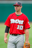 Chris Burke (10) of the Fort Wayne TinCaps warms up in the outfield prior to the game against the Lansing Lugnuts at Cooley Law School Stadium on June 5, 2013 in Lansing, Michigan.  The TinCaps defeated the Lugnuts 8-5.  (Brian Westerholt/Four Seam Images)