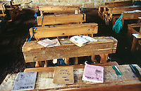 Kenya. Rift Valley Province. Mwenja. Primary school. Classroom.The notesbooks are laid on a wood desk .  © 2004 Didier Ruef