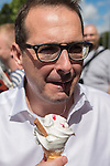 © Joel Goodman - 07973 332324 . 30/07/2016 . Liverpool , UK . OWEN SMITH eats an ice cream after holding a rally in a field off Bridgewater Street in Liverpool after the booked venue , the Camp and Furnace warehouse , reportedly cancelled the booking . Smith is campaigning to replace Jeremy Corbyn as the leader of the Labour Party . Photo credit : Joel Goodman
