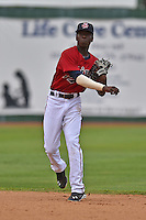 Elizabethton Twins shortstop Nick Gordon #9 throws to first during a game against the  Bristol Pirates at Joe O'Brien Field June 30, 2014 in Elizabethton, Tennessee. The Twins defeated the Pirates 8-5 in game one of a double header. (Tony Farlow/Four Seam Images)