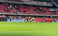 WASHINGTON, DC - APRIL 17: New York City FC and  D.C. United stand and kneel during the national anthem before a game between New York City FC and D.C. United at Audi Field on April 17, 2021 in Washington, DC.