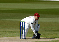 15th April 2021; Emirates Old Trafford, Manchester, Lancashire, England; English County Cricket, Lancashire versus Northants; Northamptonshire keeper Adam Rossington collects the ball from a fielder