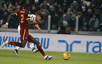 Juventus' Paulo Dybala, right, scores the winning gol as he is challenged by Roma's Antonio Ruediger during the Italian Serie A football match between Juventus and Roma at Juventus Stadium.