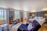 BNPS.co.uk (01202 558833)<br /> Pic: LeggettPrestige/BNPS<br /> <br /> PICTURED: One of the 10 bedrooms in the chateau<br /> <br /> A luxurious French chateau in a village liberated by the celebrated US general George Patton in World War Two has gone on the market for £1.35million.<br /> <br /> A stunning 19th century French chateau has emerged on the market for £1.35million - the same price as a terraced house in London.<br /> <br /> The Normandy property, located on the edge of the Bay of Mont Saint Michel, has 10 bedroom suites and is set in 14 hectares of manicured parkland.<br /> <br /> It also has equestrian facilities including 12 stables, as well as paddocks, a barn and a cottage.