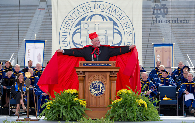 May 19, 2013; Timothy Cardinal Dolan, Archbishop of New York and Commencement speaker, jokes with the audience as he lifts his cape at the 2013 Commencement ceremony in Notre Dame Stadium. Photo by Barbara Johnston/University of Notre Dame