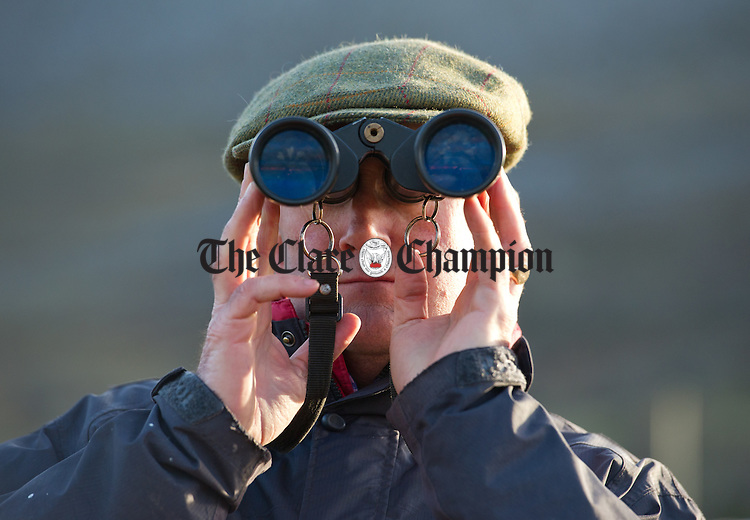 David Mc Carthy keeping an eye on all the action at the County Clare Hunt Point To Point in Bellharbour. Photograph by John Kelly.