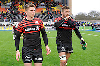 20130324 Copyright onEdition 2013©.Free for editorial use image, please credit: onEdition..Owen Farrell and Will Fraser of Saracens on a victory lap after the Premiership Rugby match between Saracens and Harlequins at Allianz Park on Sunday 24th March 2013 (Photo by Rob Munro)..For press contacts contact: Sam Feasey at brandRapport on M: +44 (0)7717 757114 E: SFeasey@brand-rapport.com..If you require a higher resolution image or you have any other onEdition photographic enquiries, please contact onEdition on 0845 900 2 900 or email info@onEdition.com.This image is copyright onEdition 2013©..This image has been supplied by onEdition and must be credited onEdition. The author is asserting his full Moral rights in relation to the publication of this image. Rights for onward transmission of any image or file is not granted or implied. Changing or deleting Copyright information is illegal as specified in the Copyright, Design and Patents Act 1988. If you are in any way unsure of your right to publish this image please contact onEdition on 0845 900 2 900 or email info@onEdition.com