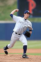 Jeff Baker #25 of the BYU Cougars pitches against the Pepperdine Waves at Eddy D. Field Stadium on April 10, 2014 in Malibu, California. BYU defeated Pepperdine, 1-0. (Larry Goren/Four Seam Images)