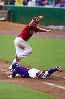 Stony Brook Seawolves first baseman Kevin Courtney #25 makes a putout at first during the NCAA Super Regional baseball game against LSU on June 9, 2012 at Alex Box Stadium in Baton Rouge, Louisiana. Stony Brook defeated LSU 3-1. (Andrew Woolley/Four Seam Images)