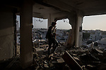 Remi OCHLIK/IP3 PRESS - On august, 28, 2011 In Tripoli - A freedom fighter visits a flat completely destroy by a shelling few days ago.