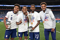 DENVER, CO - JUNE 6: Weston McKennie #8, Reggie Cannon #20 and Kellyn Acosta #23 Bryan Reynolds of the United States holding the Nations League hardware during a game between Mexico and USMNT at Mile High on June 6, 2021 in Denver, Colorado.
