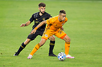 CARSON, CA - OCTOBER 28: Diego Rossi #9 of LAFC defends against Darwin Ceren #24 of the Houston Dynamo with the ball during a game between Houston Dynamo and Los Angeles FC at Banc of California Stadium on October 28, 2020 in Carson, California.