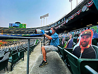 OAKLAND, CA - OCTOBER 1:  Associated Press photographer Eric Risberg works during Wild Card Round Game Three between the Chicago White Sox and the Oakland Athletics at the Oakland Coliseum on Thursday, October 1, 2020 in Oakland, California. (Photo by Brad Mangin)