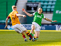 24th April 2021; Easter Road, Edinburgh, Scotland; Scottish Cup fourth round, Hibernian versus Motherwell; Alex Gogic of Hibernian is late with challenge on Robbie Crawford of Motherwell