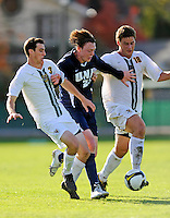 15 October 2008: University of New Hampshire Wildcats' midfielder A.J. DuBois (25), a Senior from Acworth, N.H., battles University of Vermont Catamounts' midfielder Ryan White (18), a Sophomore from Eugene, OR, and midfielder/backfielder Connor O'Brien, a Sophomore from Richmond, VT (3) at Centennial Field, in Burlington, Vermont. The Wildcats and Catamounts battled in overtime to a 0-0 tie...Mandatory Photo Credit: Ed Wolfstein Photo